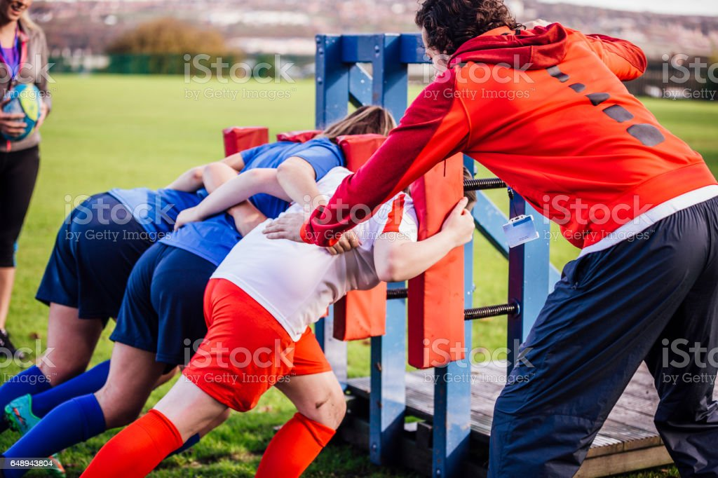 Teenage Girls Rugby Training with their Coach stock photo
