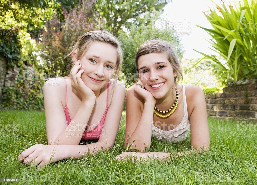 Teenage girls smile to camera royalty-free stock photo