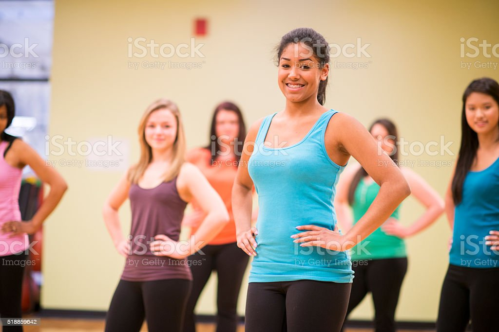 Teenage Girls Taking a Dance Fitness Class at the Gym stock photo