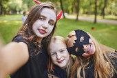 istock Teenage Girls Taking Selfie on Halloween 1274885607