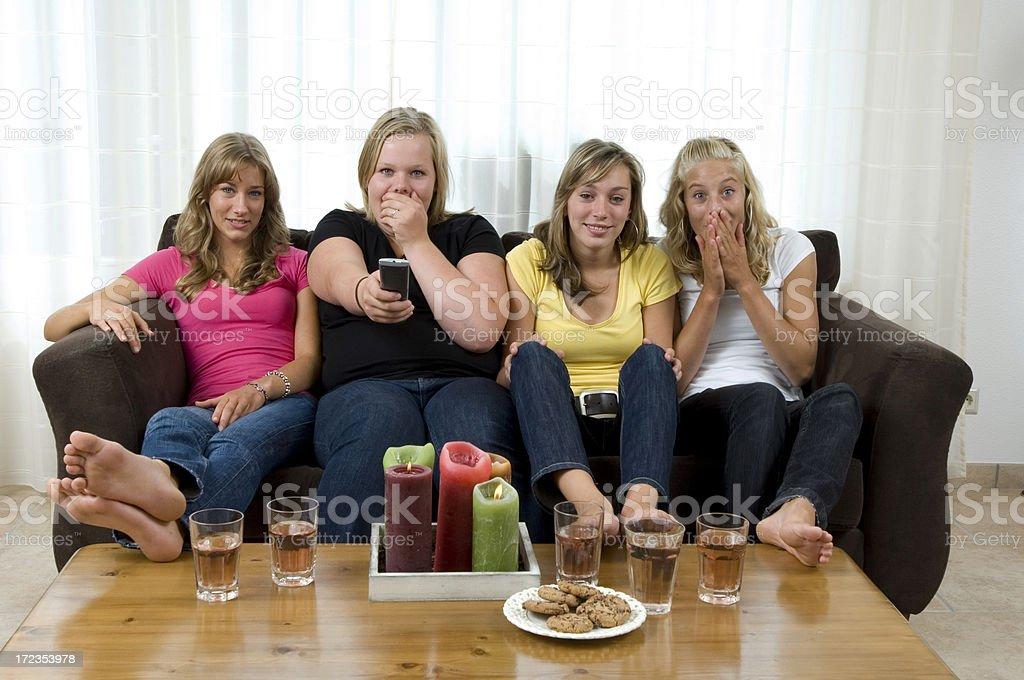 teenage girls watching tv stock photo