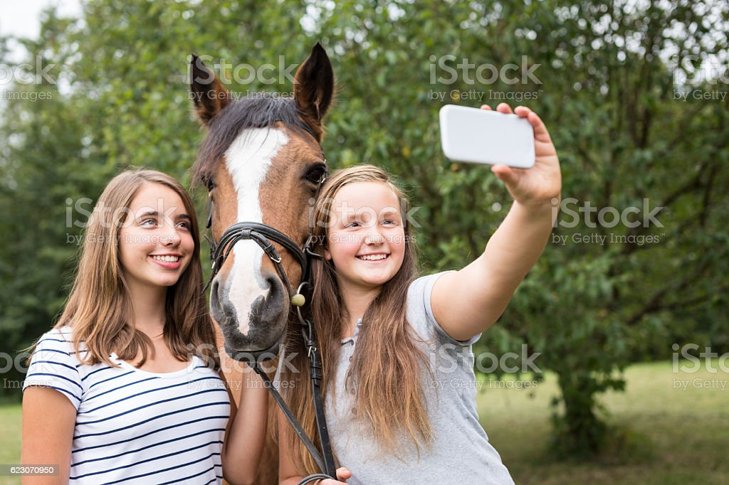 Teenage Girls With Their Pony stock photo