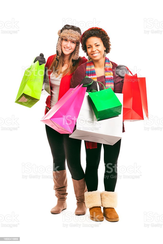 Teenage Girls, Young Women Christmas Shopping for Holidays, on White royalty-free stock photo