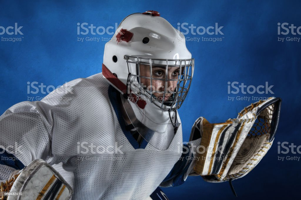 Teenage Goaltender On Blue Background Stock Photo More Pictures Of