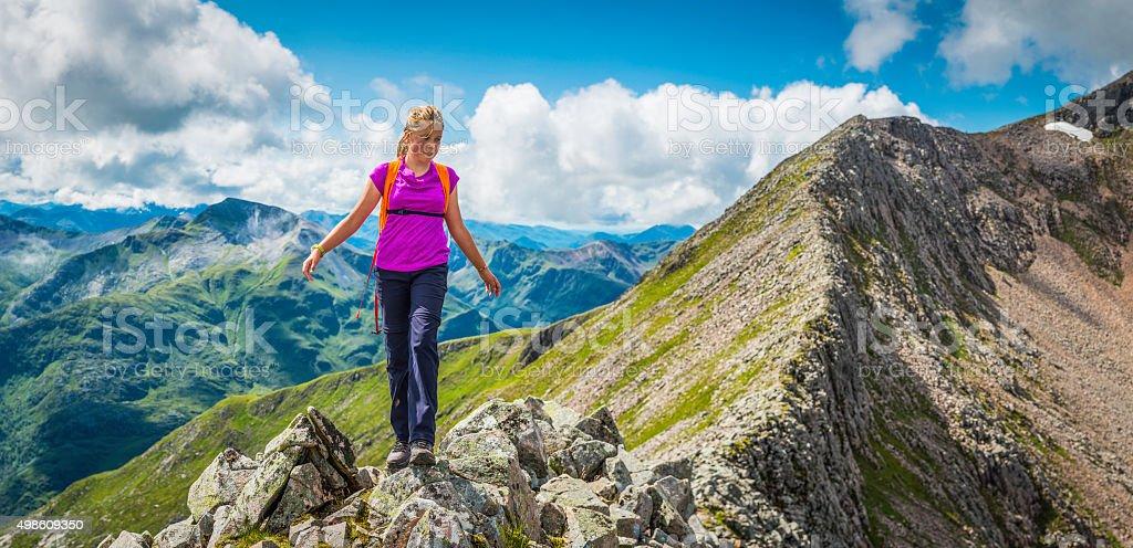 Teenage hiker climbing mountain ridge panorama Ben Nevis Highlands Scotland stock photo