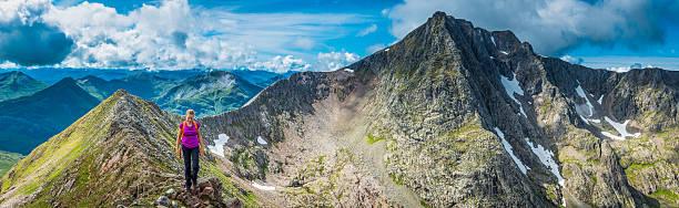 Teenage hiker climbing on Ben Nevis Highlands mountain panorama Scotland stock photo