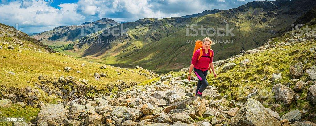 Teenage hiker walking picturesque mountain trail panorama Lake District Cumbria stock photo
