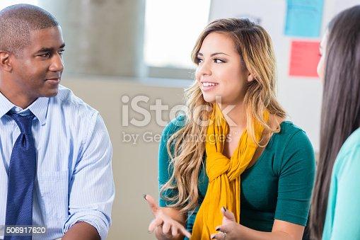 istock Teenage Hispanic girl talks in group therapy 506917620