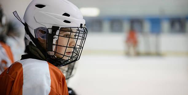Teenage Hockey Player on the Bench stock photo