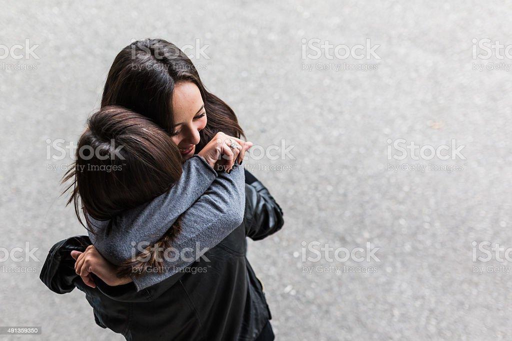 Teenage hugging stock photo
