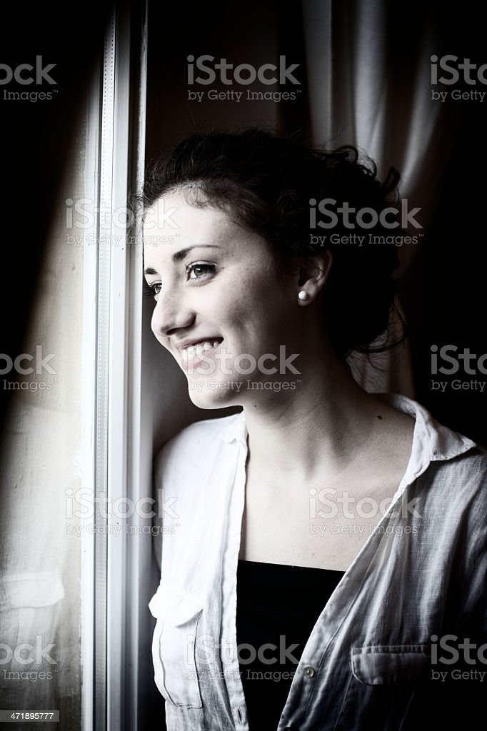 Teenage is looking through window royalty-free stock photo