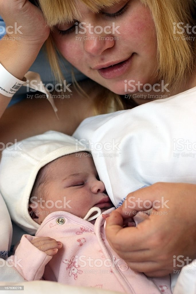 Teenage mother with newborn royalty-free stock photo