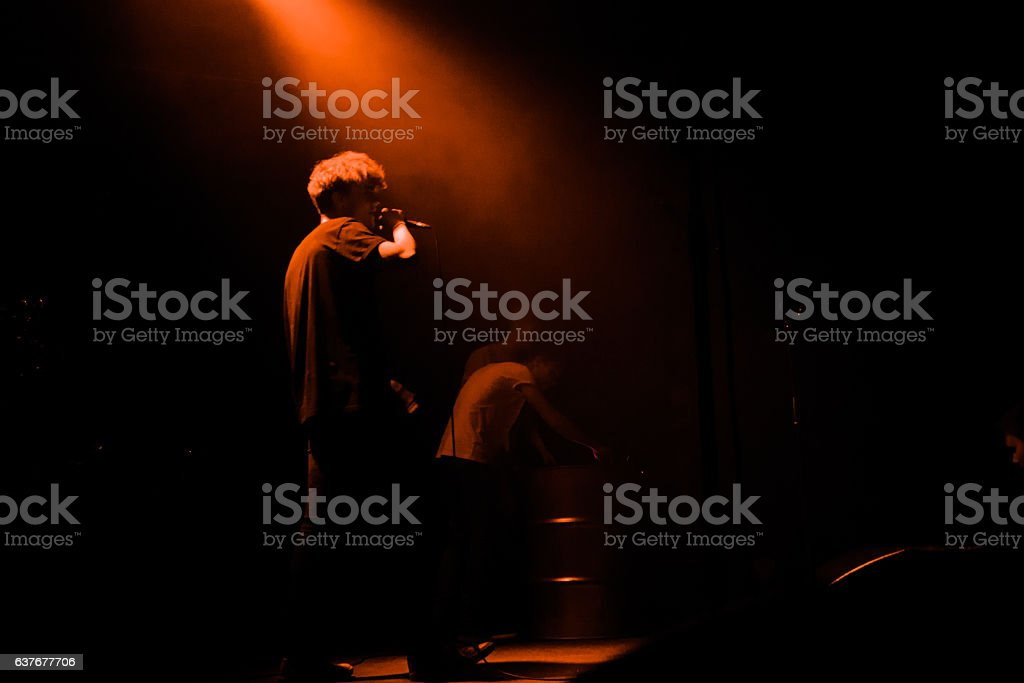 Teenage music singer in the light stock photo