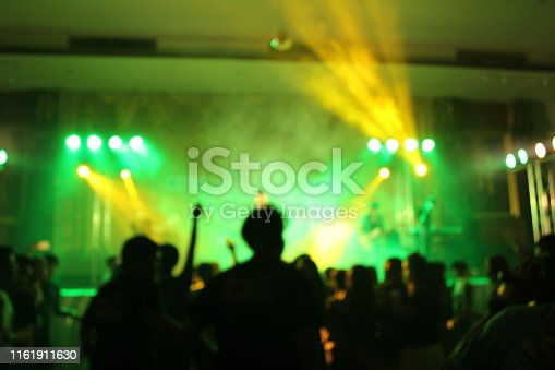 istock Teenage party with people blurred background 1161911630