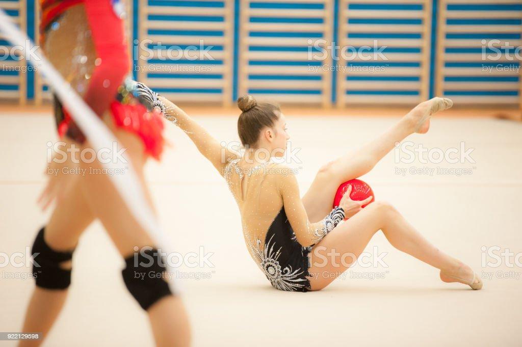 Teenage Rhythmic Gymnastics Athletes Practicing.