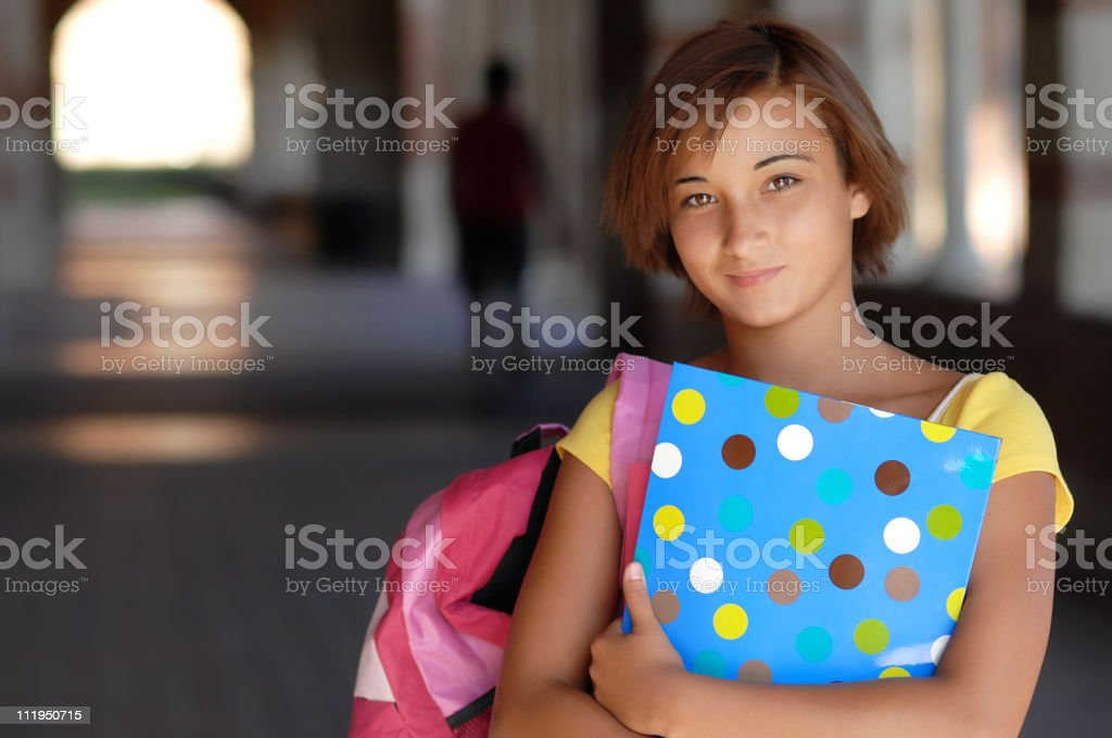 Teenage Schoolgirl Holding Books on Campus royalty-free stock photo