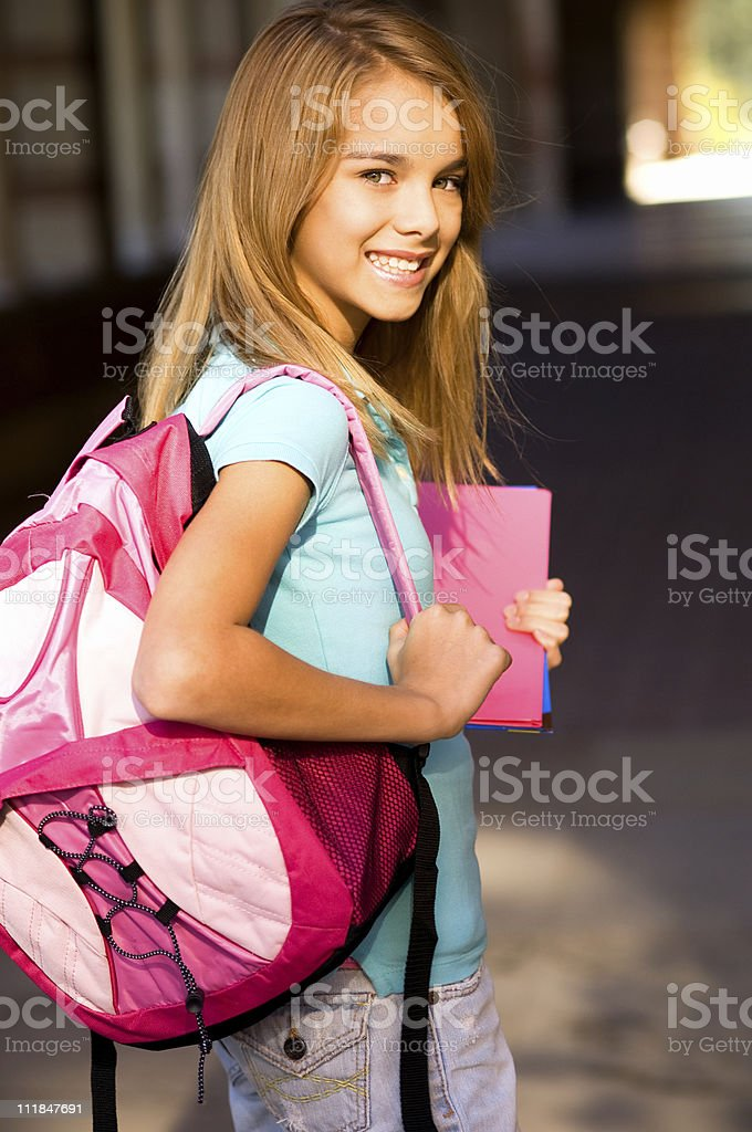 Teenage Schoolgirl With Backpack and Books on Campus royalty-free stock photo