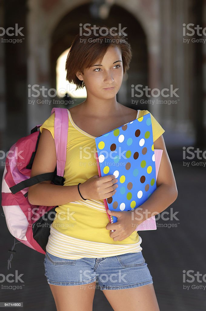 Teenage Schoolgirl with Backpack and books on Campus stock photo