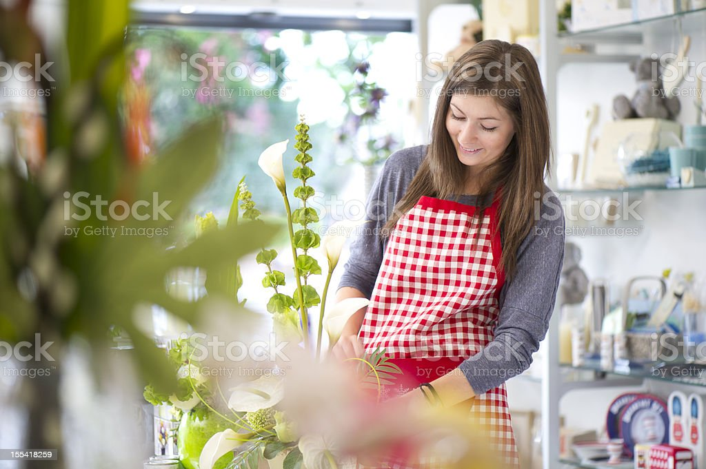 teenage shop assistant royalty-free stock photo
