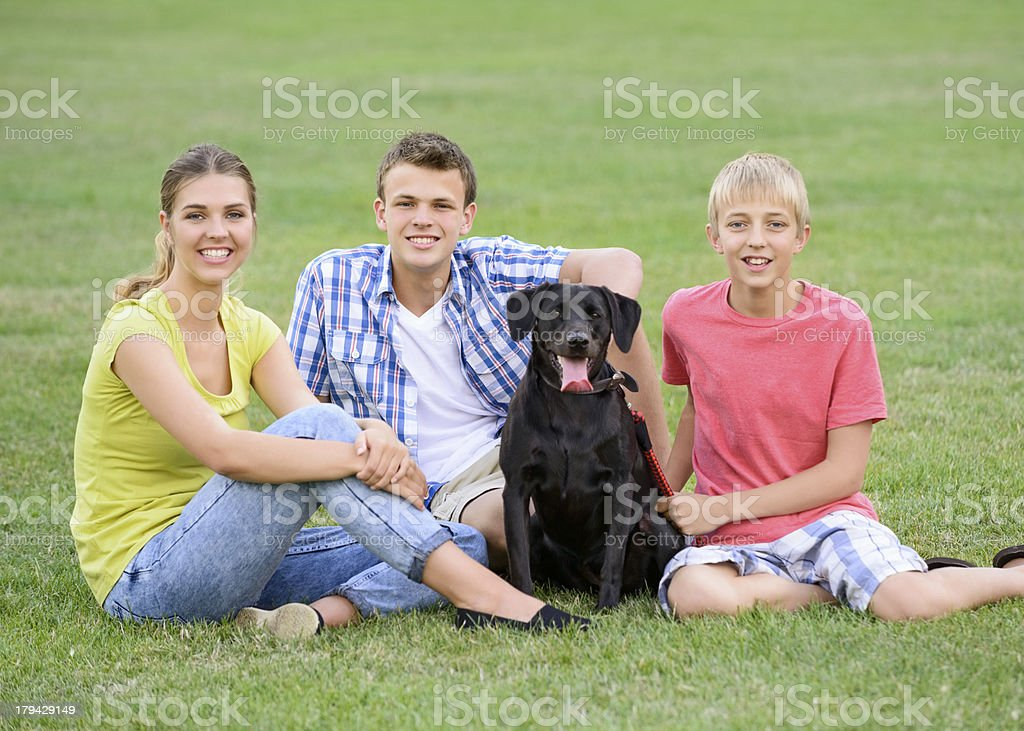 Teenage Siblings With Pet Dog Portrait royalty-free stock photo