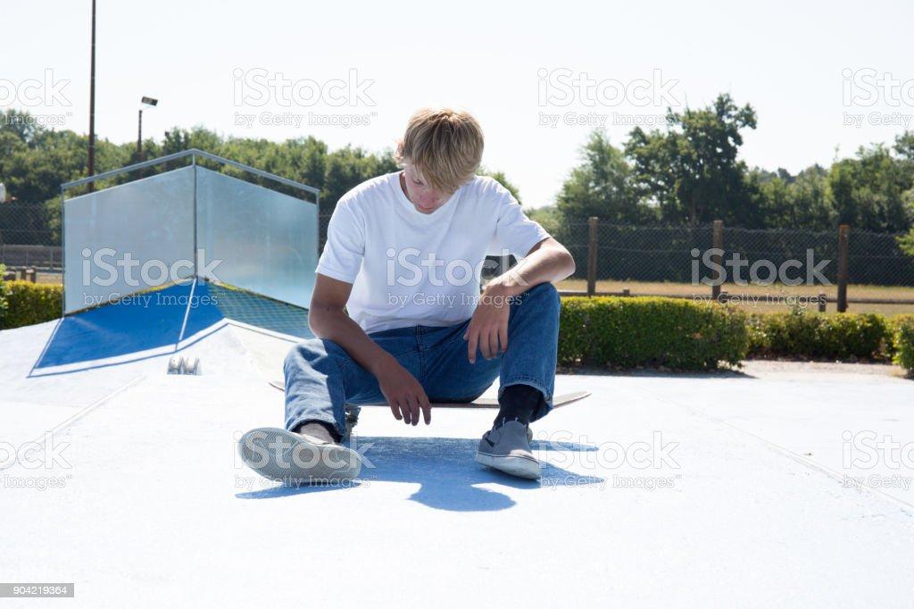 Teenage skateboarders training in a skatepark stock photo