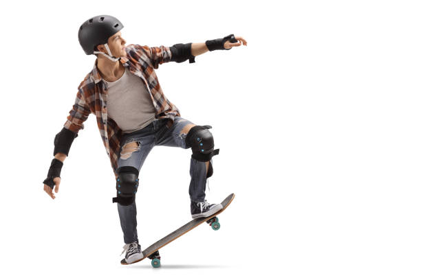 Teenage skater performing a manual stock photo
