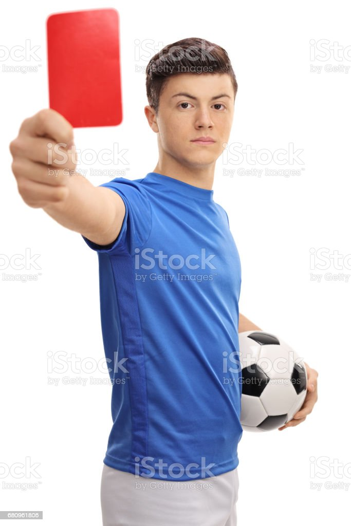 Teenage soccer player showing a red card stock photo