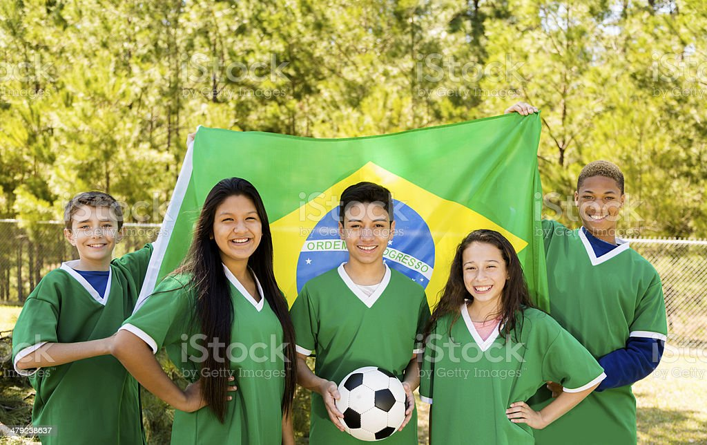 Teenage soccer team with Brazilian flag. stock photo