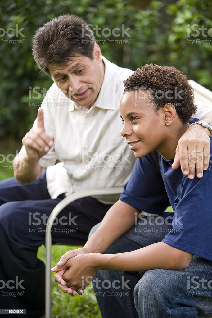 Teenage son listening to father's advice  14-15 Years Stock Photo