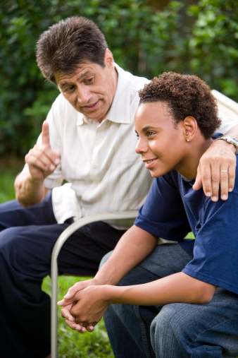 Teenage Son Listening To Fathers Advice Stock Photo - Download Image Now