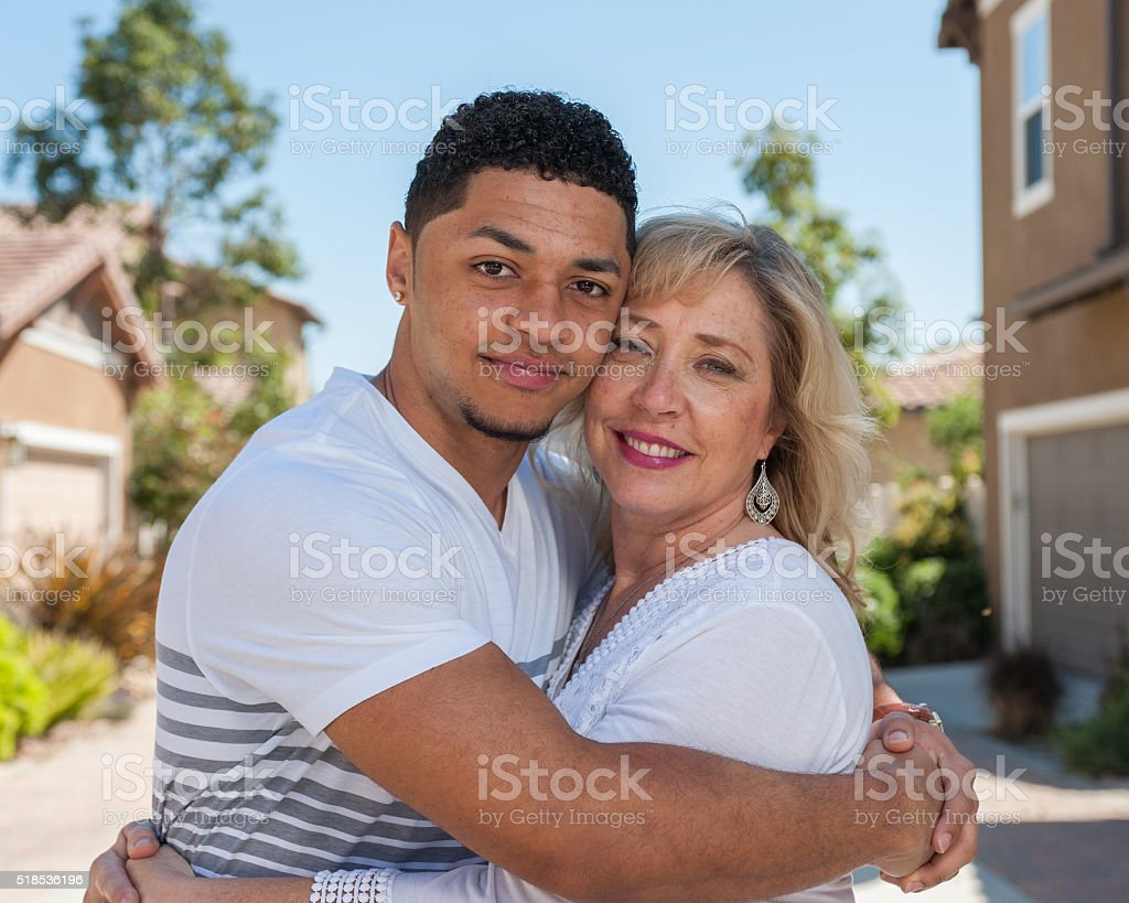 Teenage son loves his mother stock photo