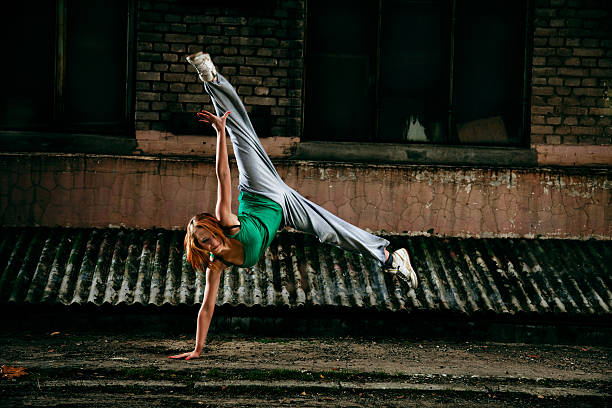Teenage street dancer Young girl dancing against grunge wall. new age music stock pictures, royalty-free photos & images