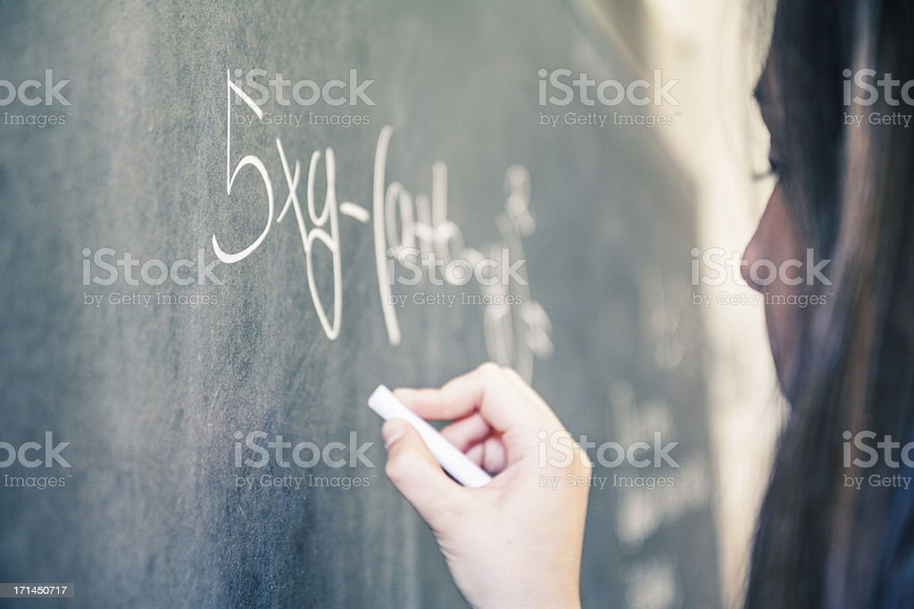 Teenage student at the blackboard stock photo