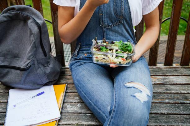 Teenage student having healthy lunch stock photo