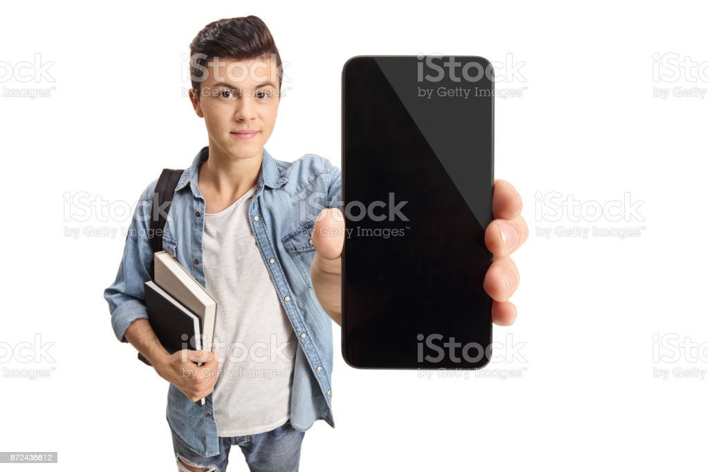 Teenage student showing a phone stock photo