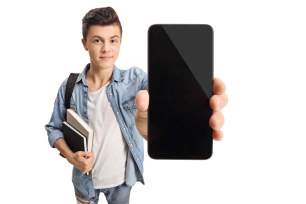 10 代の学生が携帯電話を表示 - 見せる ストックフォトと画像