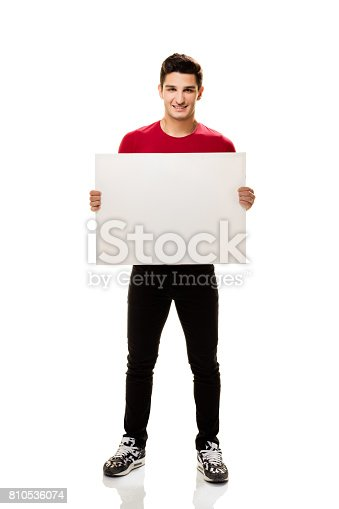istock Teenage student showing placard. 810536074
