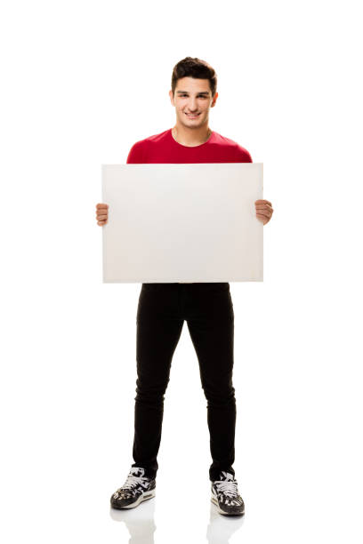 Teenage student showing placard. stock photo