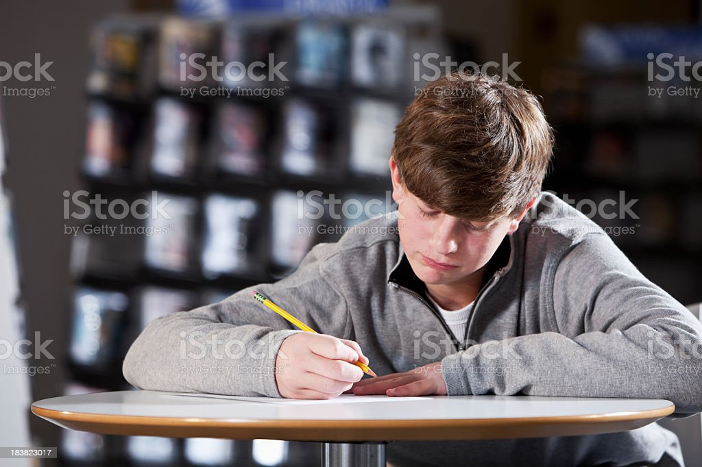 Teenage student taking test royalty-free stock photo