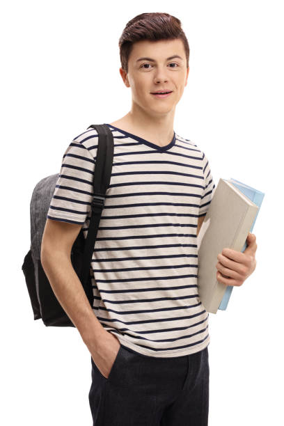 Teenage student with a backpack and books stock photo