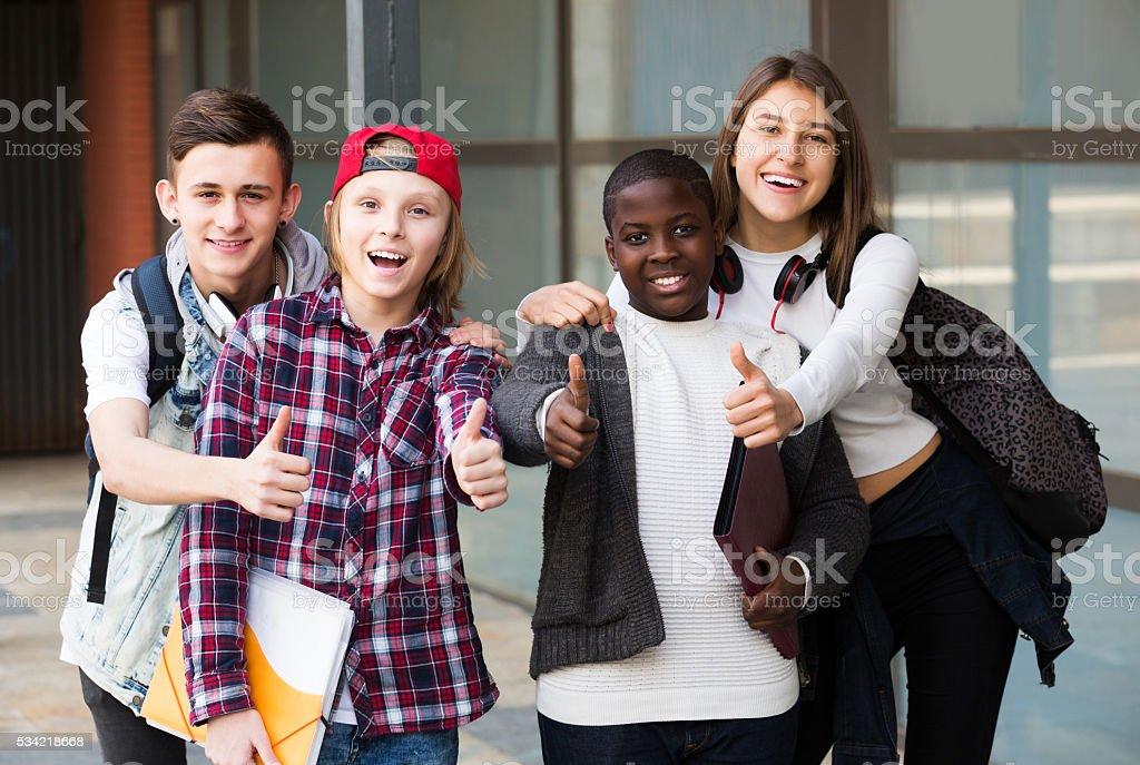 Teenage students close to university stock photo