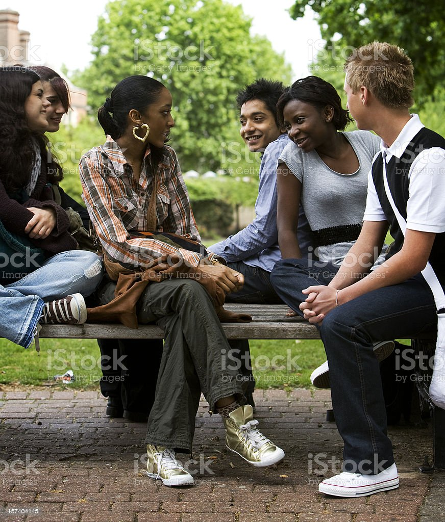 Teenage students hang out during a break royalty-free stock photo