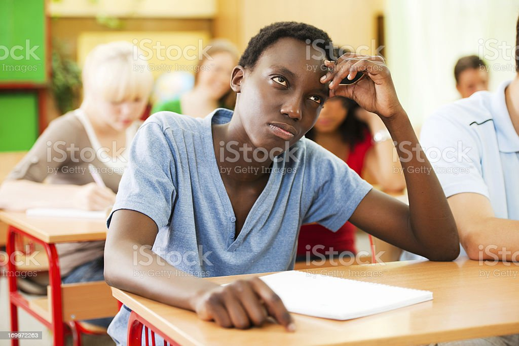 Teenage students sitting in the classroom. royalty-free stock photo