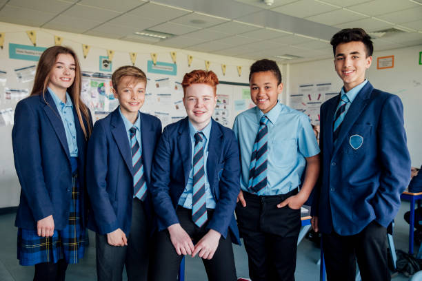 Teenage Students Standing for a Photo stock photo