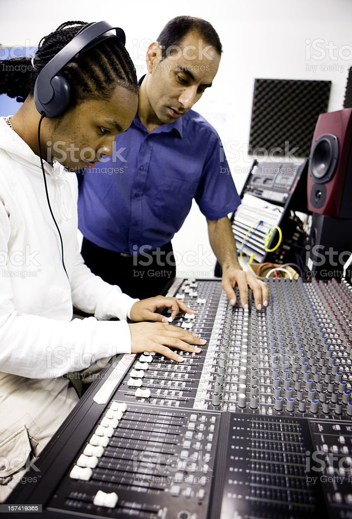 teenage students: student discovering how to use a mixing desk stock photo