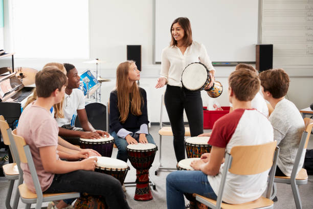 Teenage Students Studying Percussion In Music Class Teenage Students Studying Percussion In Music Class drum percussion instrument stock pictures, royalty-free photos & images
