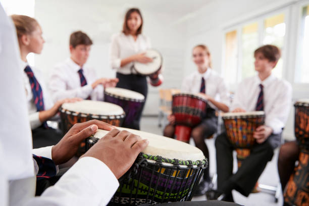 Teenage Students Studying Percussion In Music Class stock photo