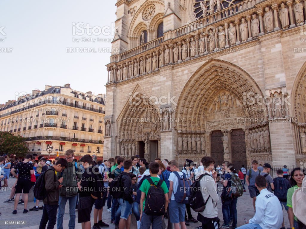 Teenage Students Wait In Front Of Notre Dame Paris France Stock