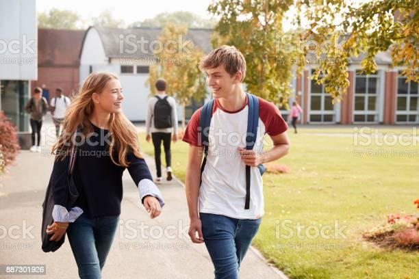 Teenage students walking around college campus together picture id887301926?b=1&k=6&m=887301926&s=612x612&h=dwnkila nnkzjxkxu evl5wjj uurzaigtj5in8cqrg=
