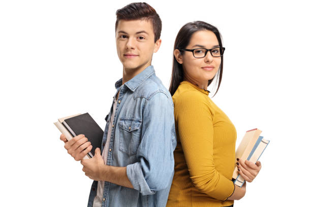 Teenage students with books with their backs against each other Teenage students with books with their backs against each other isolated on white background schoolboy stock pictures, royalty-free photos & images